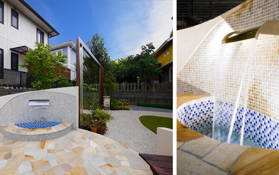 リゾートホテルの様な壁泉があるお庭